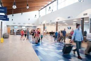 Travelers passing through new terminal.